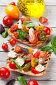 Bruschetta with tomatoes, mozzarella and basil