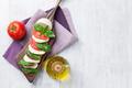 Caprese salad. Mozzarella, tomatoes and basil