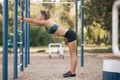 Female doing dips workout