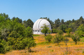Telescope with a closed dome surrounded by trees - PhotoDune Item for Sale
