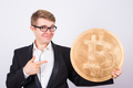 Businessman holding  bitcoin. Crypto currency, virtual money concept