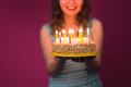 attractive teenage girl celebrating her birthday with cake - PhotoDune Item for Sale