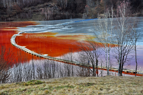Natural disaster. Pollution of a lake with contaminated water from a gold mine - Stock Photo - Images