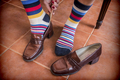 Woman putting on shoes to him vintage with colors socks
