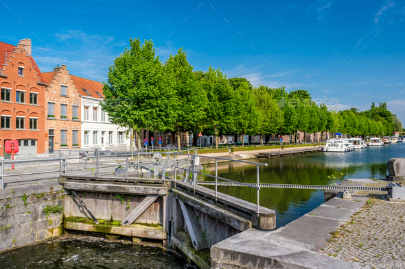 Bruges (Brugge) cityscape with water canal and bridge - Stock Photo - Images