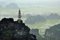 Rice fields, limestone rocks and mountaintop pagoda from Hang Mua Temple, Ninh Binh, Vietnam