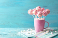 Pink cake pops in a teacup