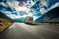 Caravan car travels on the highway. - PhotoDune Item for Sale