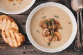 Cream soup puree with mushroom on wooden background