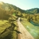 Low Air Flight Over Mountain Rural Dirt Road and Meadow at Sunny Summer Morning - VideoHive Item for Sale