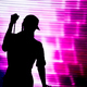 Silhouette of an artist singing live on the stage in the front of a colorful background - PhotoDune Item for Sale