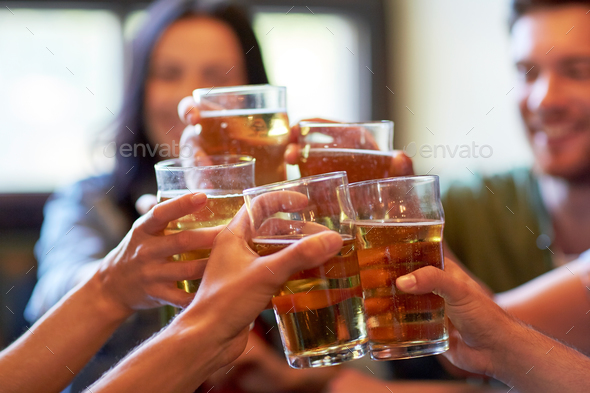 happy friends drinking beer at bar or pub - Stock Photo - Images