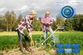 senior couple with shovel picking carrots on farm