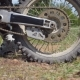 Wheel of Motocross Bike Starting To Spin and Kicking Up Ground or Dirt. Motorcycle Starts - VideoHive Item for Sale