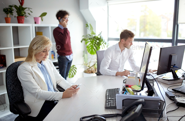 business team with smartphones at office - Stock Photo - Images