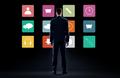 businessman in suit looking at virtual menu icons