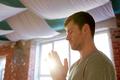 close up of man meditating at yoga studio