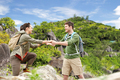 couple with backpacks traveling over exotic island