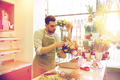 florist man making bunch at flower shop - PhotoDune Item for Sale