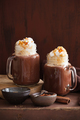 hot chocolate with whipped cream caramel in mason jar