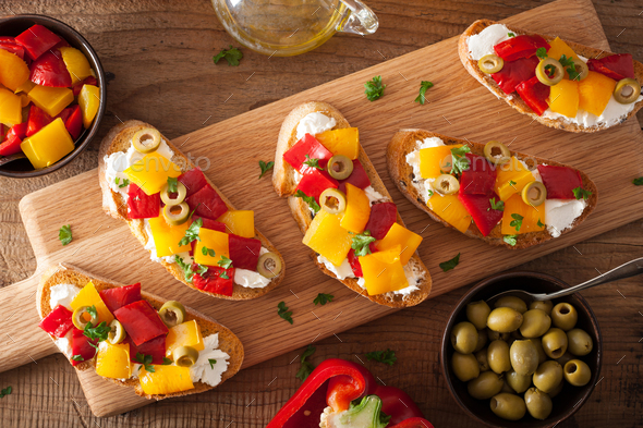 italian bruschetta with roasted peppers goat cheese olives - Stock Photo - Images