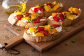 italian bruschetta with peppers goat cheese olives