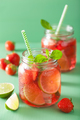 summer strawberry lemonade with lime and mint in jars