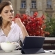 Brunette Lady Eats Salad and Watches Something on Her Tablet While She Sits in the Restaurant Before - VideoHive Item for Sale