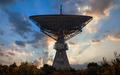 Silhouette of an old huge radio telescope