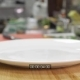 Empty Clean White Plate Stands on a Wooden Table Plate Prepared To Serve a Dish in a Restaurant or - VideoHive Item for Sale