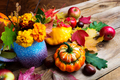 Autumn flowers, apples and pumpkins seasonal arrangement