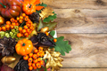 Fall arrangement with pumpkins and berries