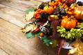 Fall or Thanksgiving holiday arrangement with pumpkins and autum