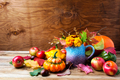 Rustic Thanksgiving arrangement with pumpkins and tagetes flower
