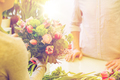close up of florist woman and man at flower shop