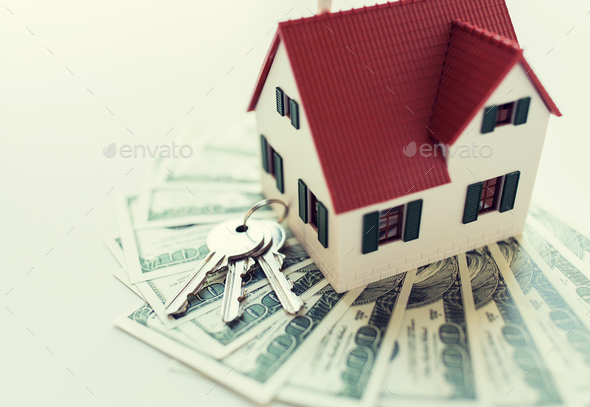 close up of home model, money and house keys - Stock Photo - Images