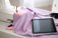 sewing machine, tablet pc, fabric and threads