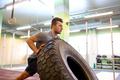 man doing strongman tire flip training in gym - PhotoDune Item for Sale