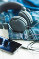 Headphones, cellphone and blue jeans. - PhotoDune Item for Sale