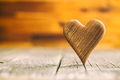 Wooden heart on wooden table. - PhotoDune Item for Sale