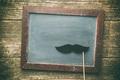 Blank chalkboard and fake mustache.