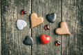 Various hearts on wooden table. - PhotoDune Item for Sale