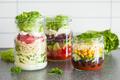 healthy vegetable cheese salad in mason jars
