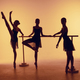 Composition from silhouettes of three young dancers in ballet poses on a orange background. - PhotoDune Item for Sale