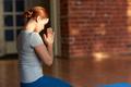 woman meditating at yoga studio