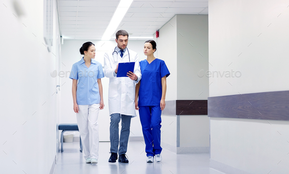 group of medics at hospital with clipboard - Stock Photo - Images