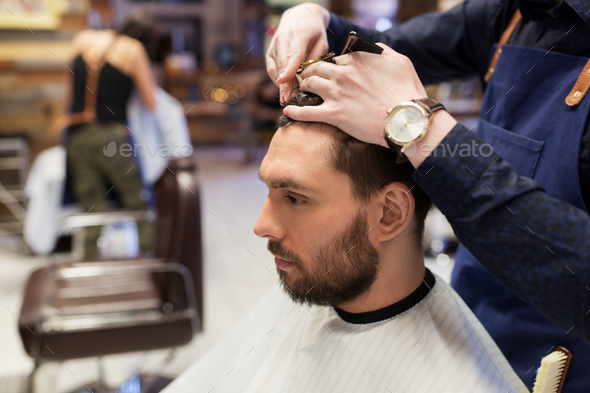 man and barber cutting hair at barbershop - Stock Photo - Images