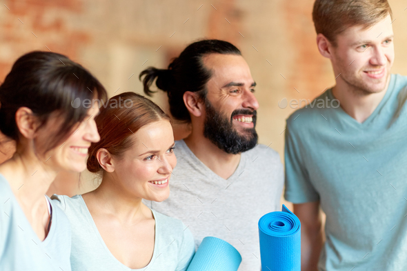 group of people with mats at yoga studio or gym - Stock Photo - Images