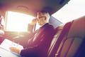 senior businessman with papers driving in car - PhotoDune Item for Sale