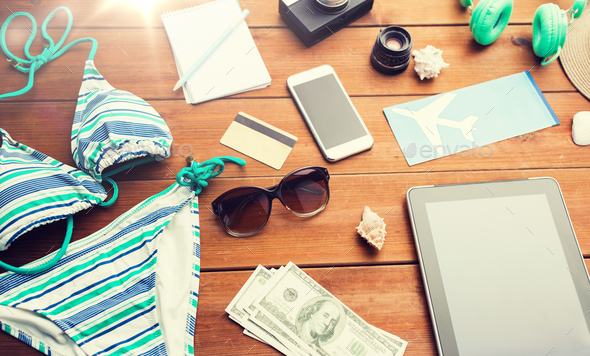 close up of tablet pc and travel stuff - Stock Photo - Images